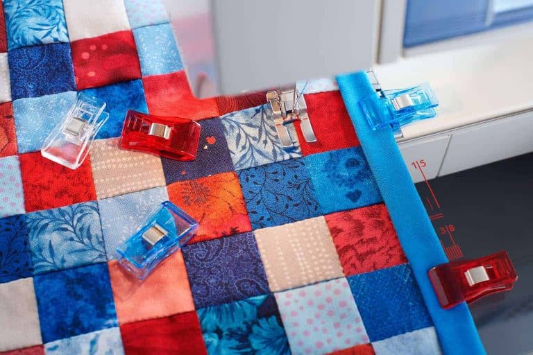 Blue and Red Quilt on a Machine