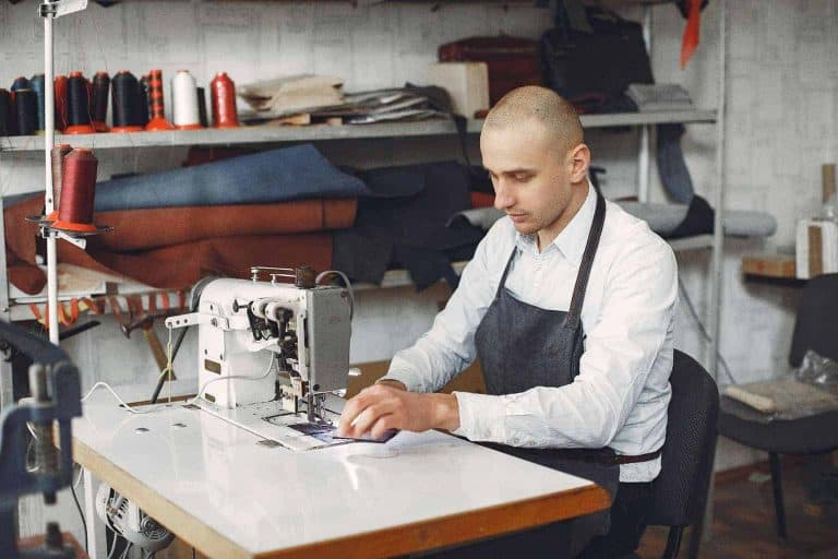 Man Sewing Leather