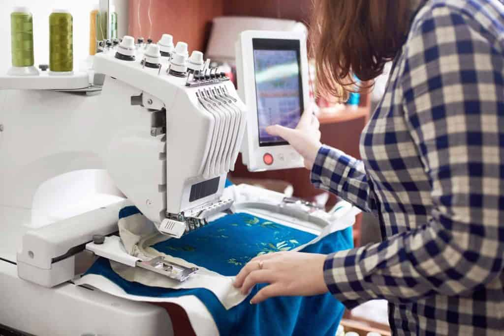 Person Modifying Settings on Embroidery Machine