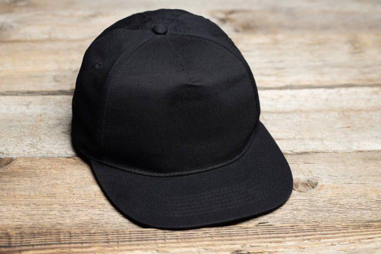 Plain Black Cap on Wooden Surface