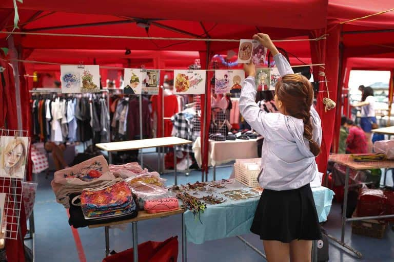 Seller Decorating a Stall
